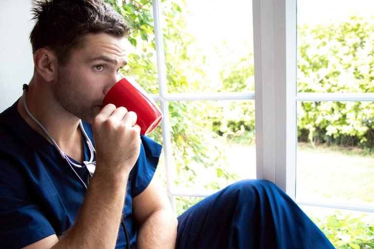 Male Nurse Drinking Coffee on Break