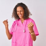 Young nurse wearing pink scrubs with stethoscope