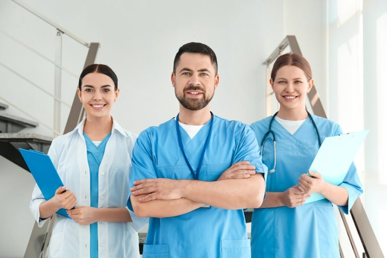 Group of nurses standing in stairwell