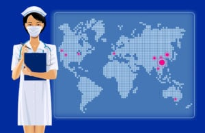 Nurse wearing mask standing in front of hot spot map