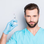 Male CRNA holding needle