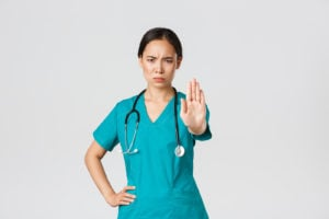 Nurse holding up hand to say stop
